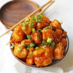 Firecracker Chicken. Sweet and spicy chicken bites made with tender chicken, flash-fried, and baked in a sweet brown sugar buffalo sauce. You'll have people coming back for seconds in no time at all! www.modernhoney.com #firecrackerchicken #buffalochicken #chicken #chickenbites