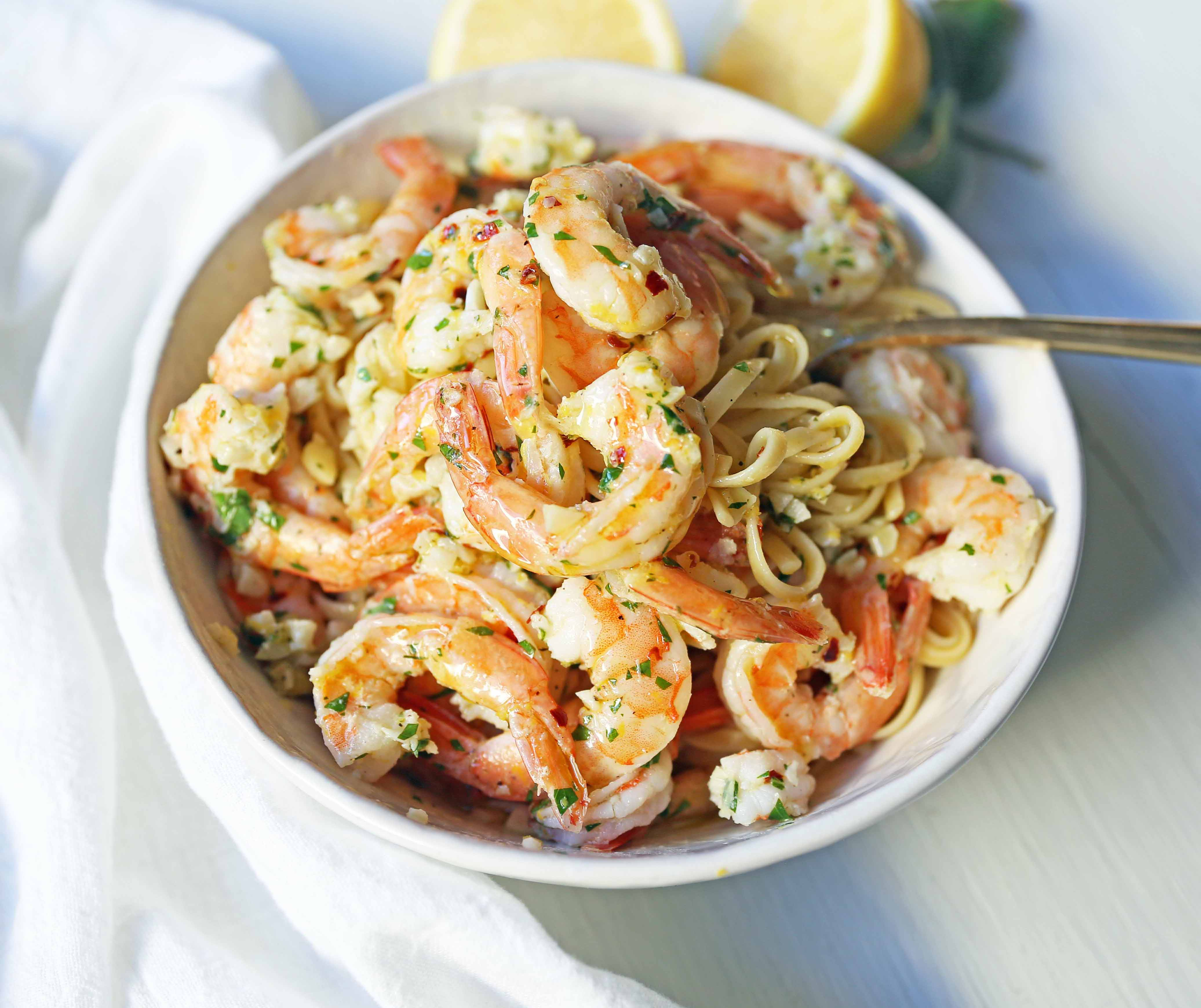 Shrimp Scampi Linguine. Shrimp sauteed in a lemon garlic butter sauce tossed with linguine pasta and made in less than 20 minutes.www.modernhoney.com #shrimp #shrimpscampi #shrimpscampilinguine #pasta #valentinesday