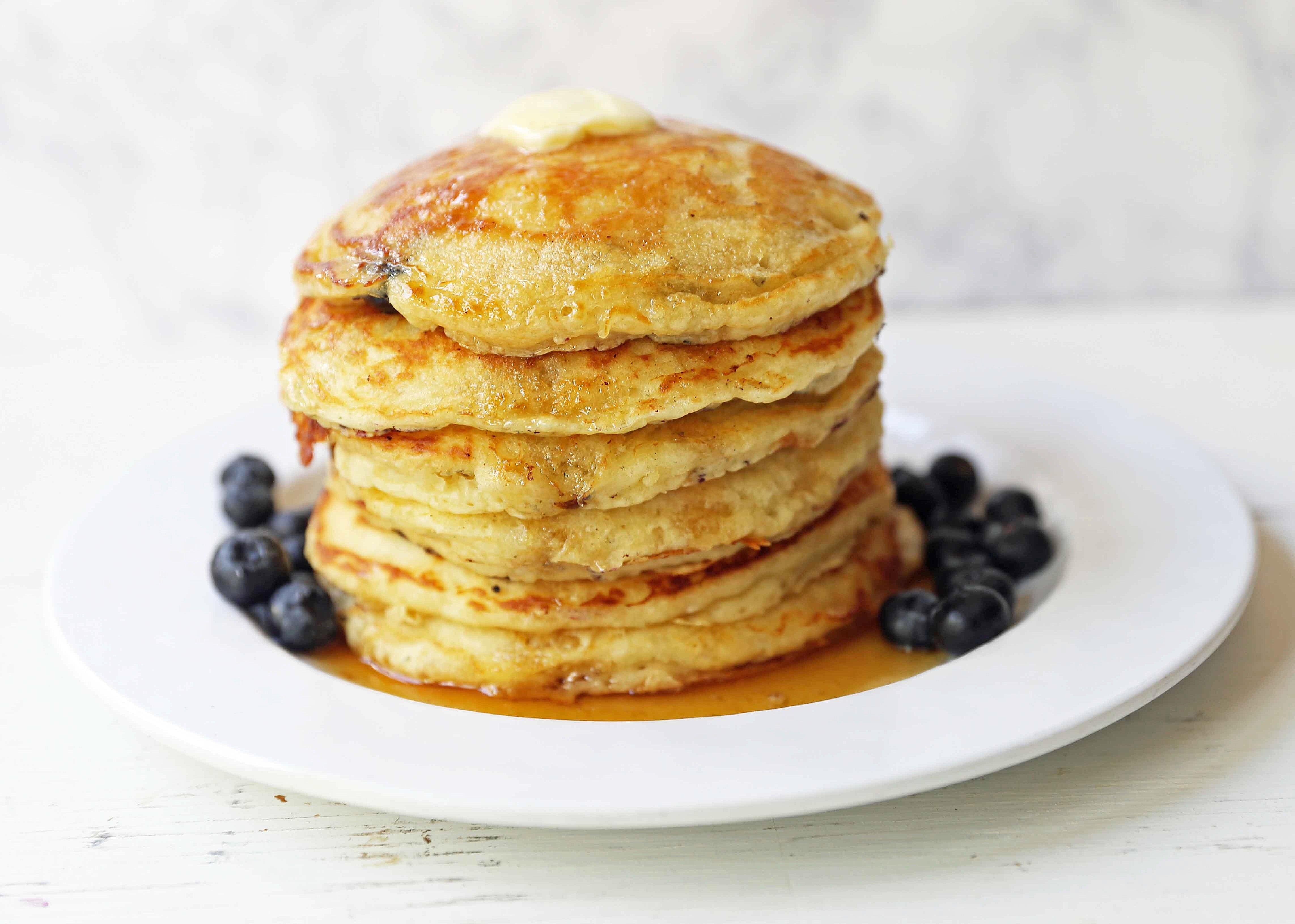 Homemade Blueberry Buttermilk Pancakes are light and fluffy. How to make the perfect blueberry pancakes. Tips and tricks for making the best blueberry pancakes. www.modernhoney.com #blueberrypancakes #blueberrybuttermilkpancakes #pancakes #pancakerecipes