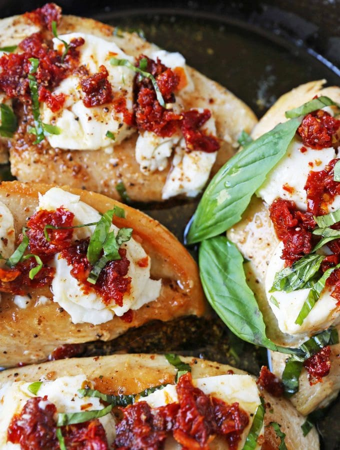 Chicken Bryan. Grilled chicken with a basil lemon butter sauce topped with sundried tomatoes and creamy goat cheese. A Carrabba's favorite! www.modernhoney.com #chickenbryan #carrabbas #chicken