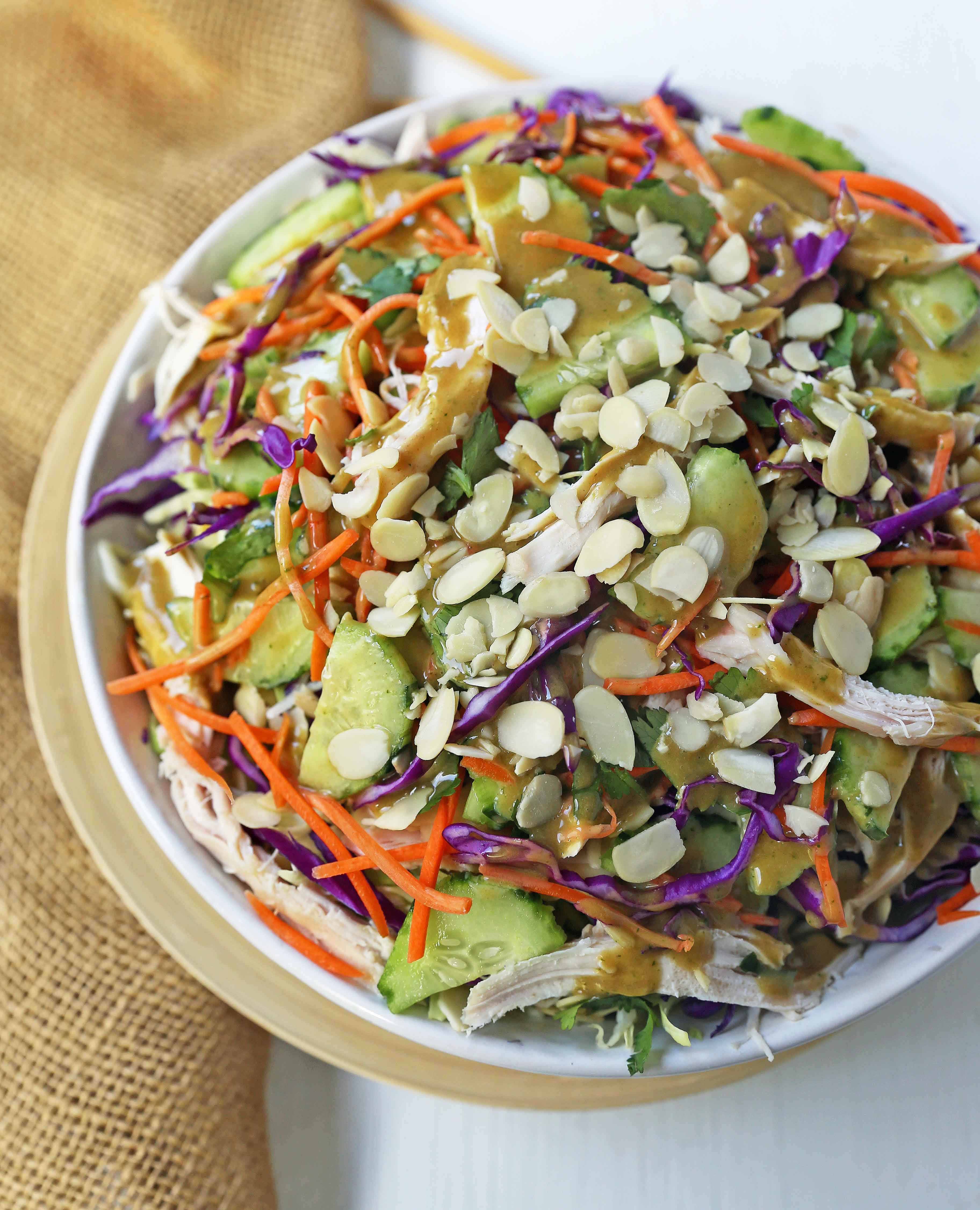 Thai Chicken Salad with Peanut Dressing. Crunchy Thai salad with cabbage, carrots, cucumber, slivered almonds, tender chicken in a homemade peanut dressing. A flavorful Chinese Chicken Salad. www.modernhoney.com #asiansalad #chickensalad #thaichickensalad #chinesechickensalad
