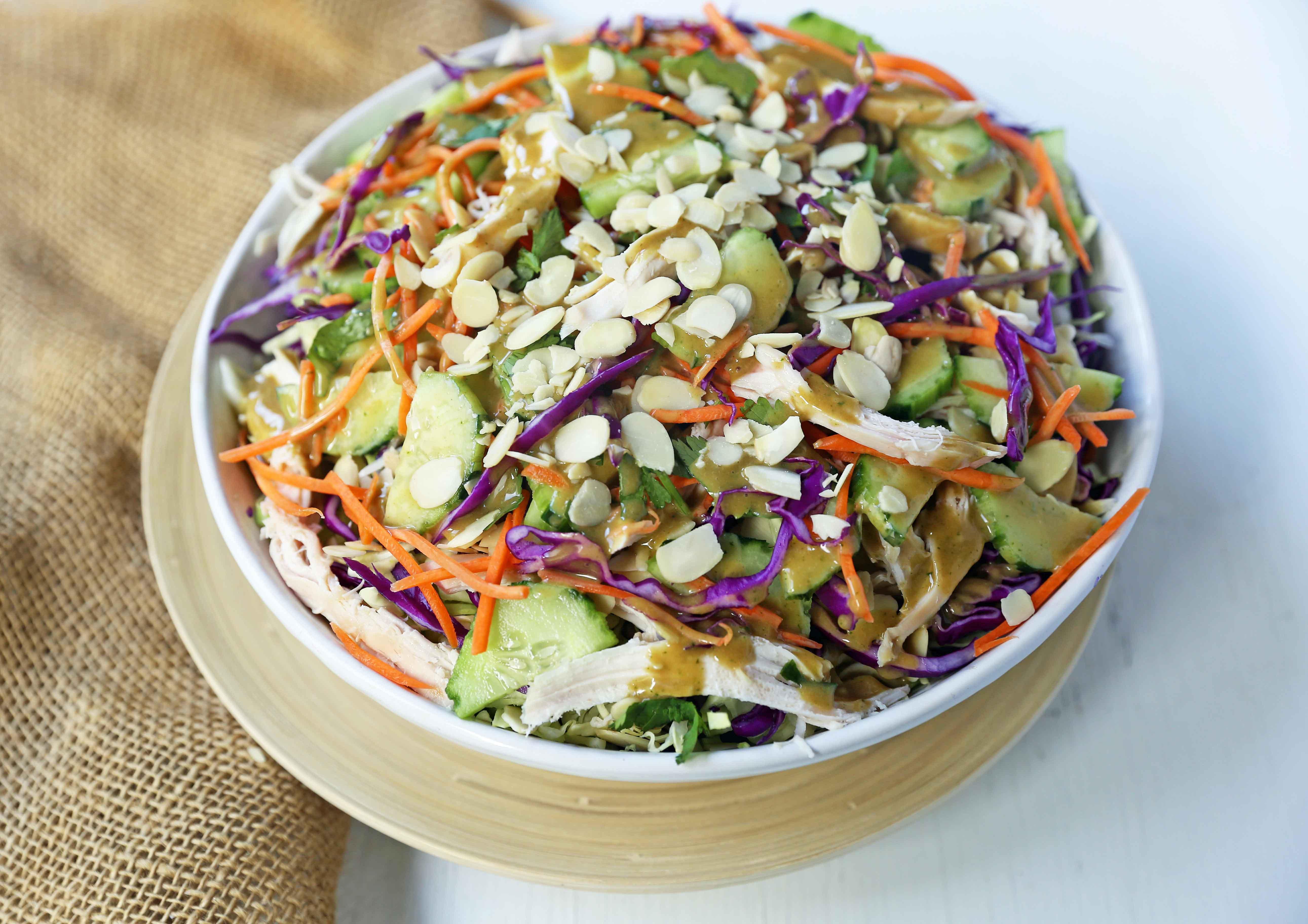 Thai Chicken Salad with Peanut Dressing. Crunchy Thai salad with cabbage, carrots, cucumber, slivered almonds, tender chicken in a homemade peanut dressing. A flavorful Chinese Chicken Salad. www.modernhoney.com #asiansalad #chickensalad #thaichickensalad #chinesechickensalad