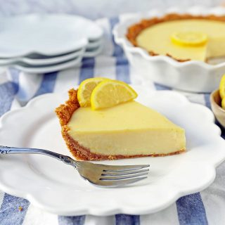 Lemon Cream Pie. A simple creamy lemon cream pie with fresh lemon zest in a buttery graham cracker crust with sweetened whipped cream. The BEST Lemon Pie Recipe. www.modernhoney.com #lemonpie #lemoncreampie #lemonpierecipe