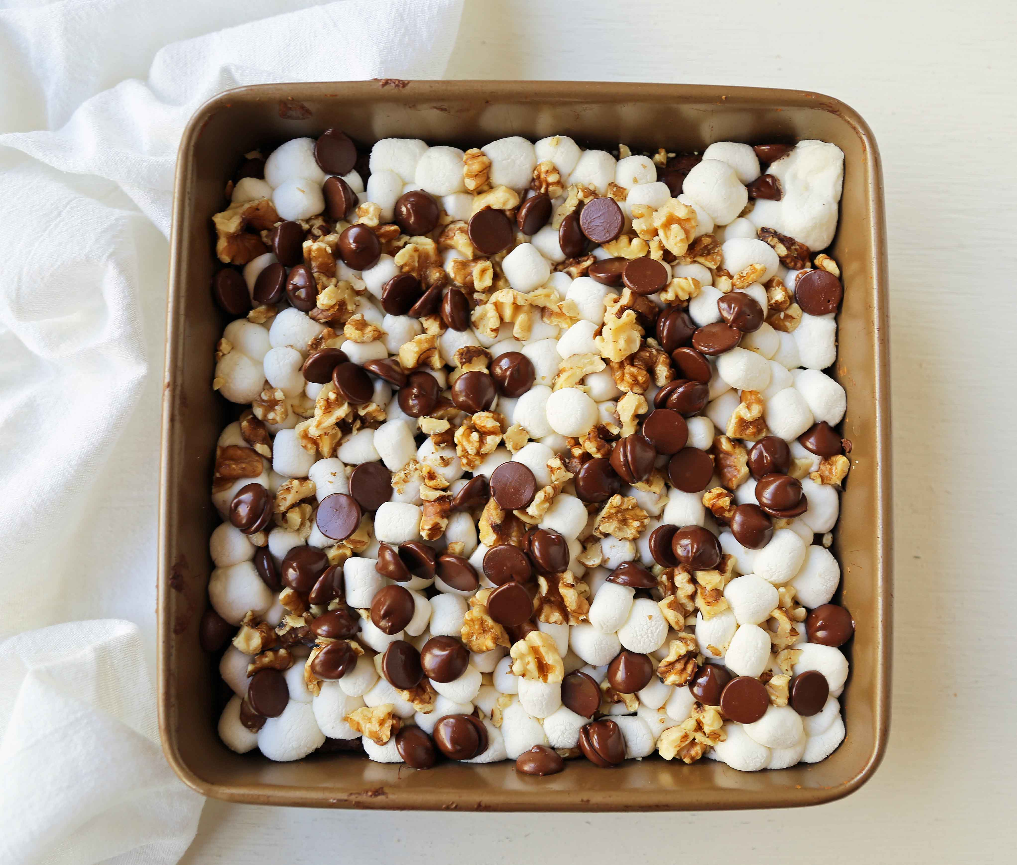 Rocky Road Brownies. Homemade decadent chocolate brownies topped with melted marshmallows, chocolate chips, and walnuts. A classic brownie! www.modernhoney.com #rockyroad #rockyroadbrownies #gourmetbrownies