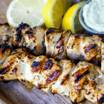 Greek Chicken Kabobs Yogurt marinated and Greek spiced chicken grilled to perfection and dipped in homemade tzatziki sauce. www.modernhoney.com #greek #greekfood #chickenkabobs #greekchickenkabobs