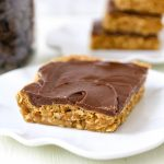 Chocolate Peanut Butter Cookie Bars Peanut Butter Oatmeal Cookie Bars with a Creamy Chocolate Frosting. A chocolate peanut butter lover's dream! Peanut Butter Fingers Recipe. www.modernhoney.com #chocolatepeanutbutter #peanutbutterbars #dessertbars