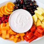 Fruit Dip Creamy, fluffy fruit dip made with cream cheese, sweetened condensed milk, homemade whipped cream, and a touch of cherry juice. The best fruit dip recipe! www.modernhoney.com #fruitdip #creamyfruitdip #creamcheesedip