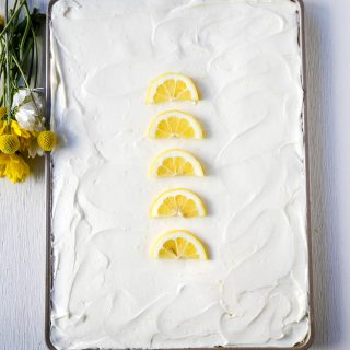 Lemon Sheet Cake Recipe. Moist sour cream lemon sheet cake recipe with a fresh lemon cream cheese frosting. #lemonsheetcake #cake