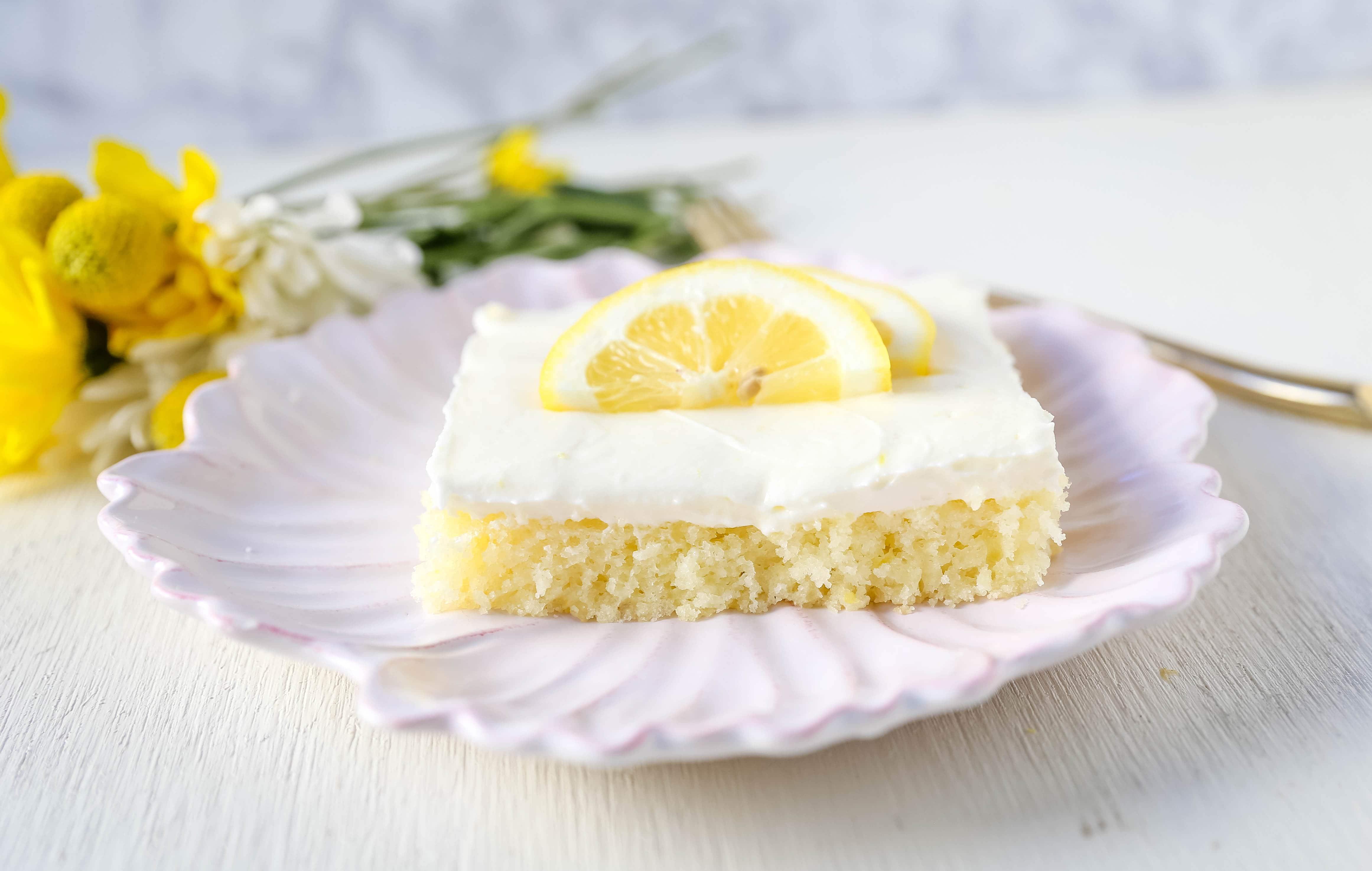 Lemon Sheet Cake Recipe. Moist sour cream lemon sheet cake recipe with a fresh lemon cream cheese frosting. #lemonsheetcake #cake