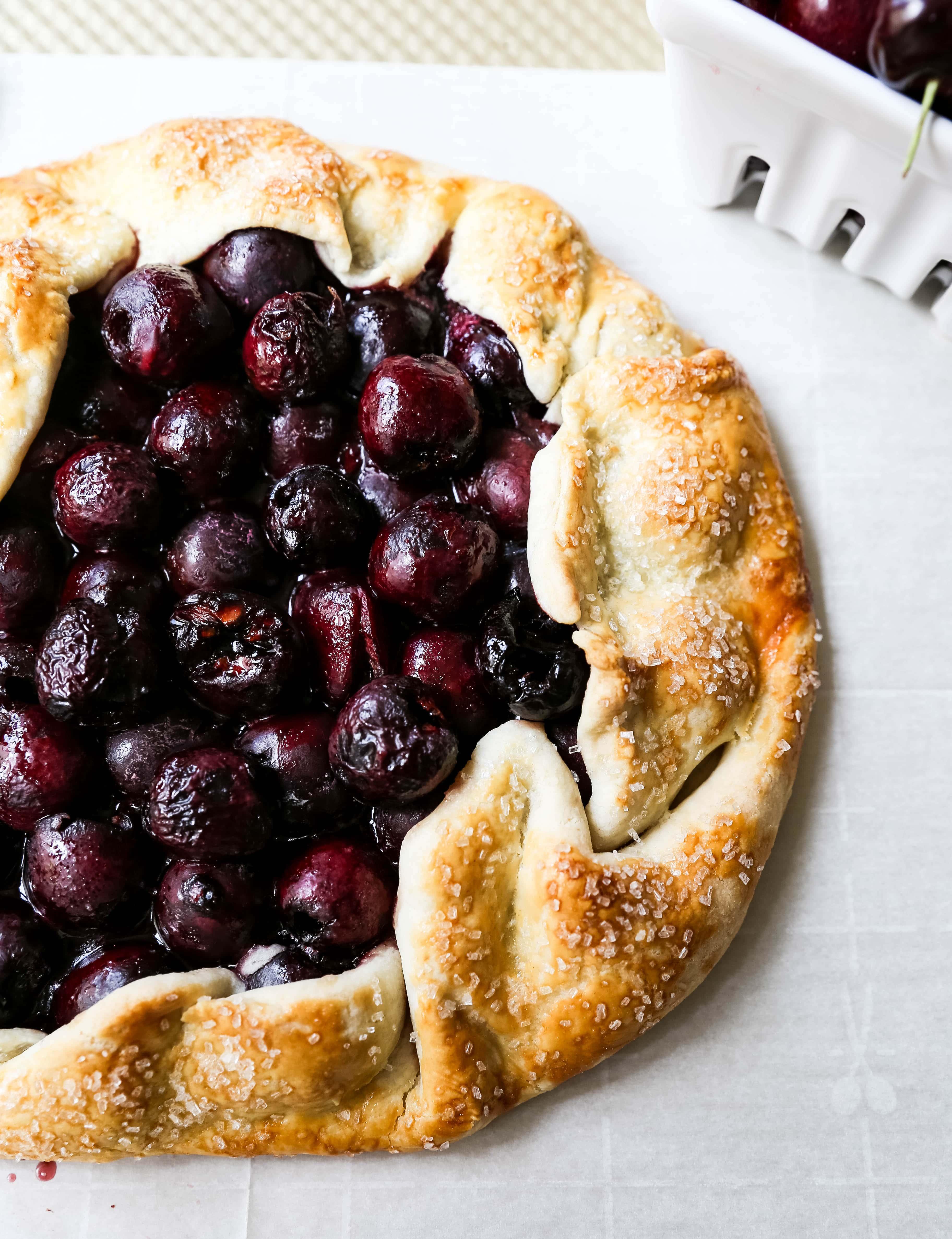 Cherry Galette. Fresh sweet cherries baked in a homemade rustic pie crust and topped with vanilla bean ice cream. The Best Cherry Crostata Recipe. www.modernhoney.com #cherrygalette #cherrycrostata #cherries #cherry #cherrydessert
