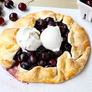 Cherry Galette. Fresh sweet cherries baked in a homemade rustic pie crust and topped with vanilla bean ice cream. The Best Cherry Crostata Recipe. www.modernhoney.com #cherrygalette #cherrycrostata #cherries #cherry #cherrydessert