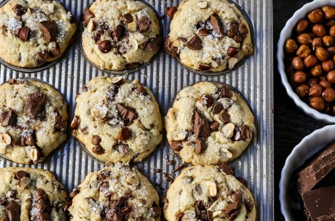 The Best Chocolate Chip Muffins. Chocolate Chunk Hazelnut Muffins with rich chocolate chips and crunchy hazelnuts. A gourmet bakery style muffin recipe. www.modernhoney.com #muffin #muffins #chocolatechipmmuffin #chocolatehazelnut