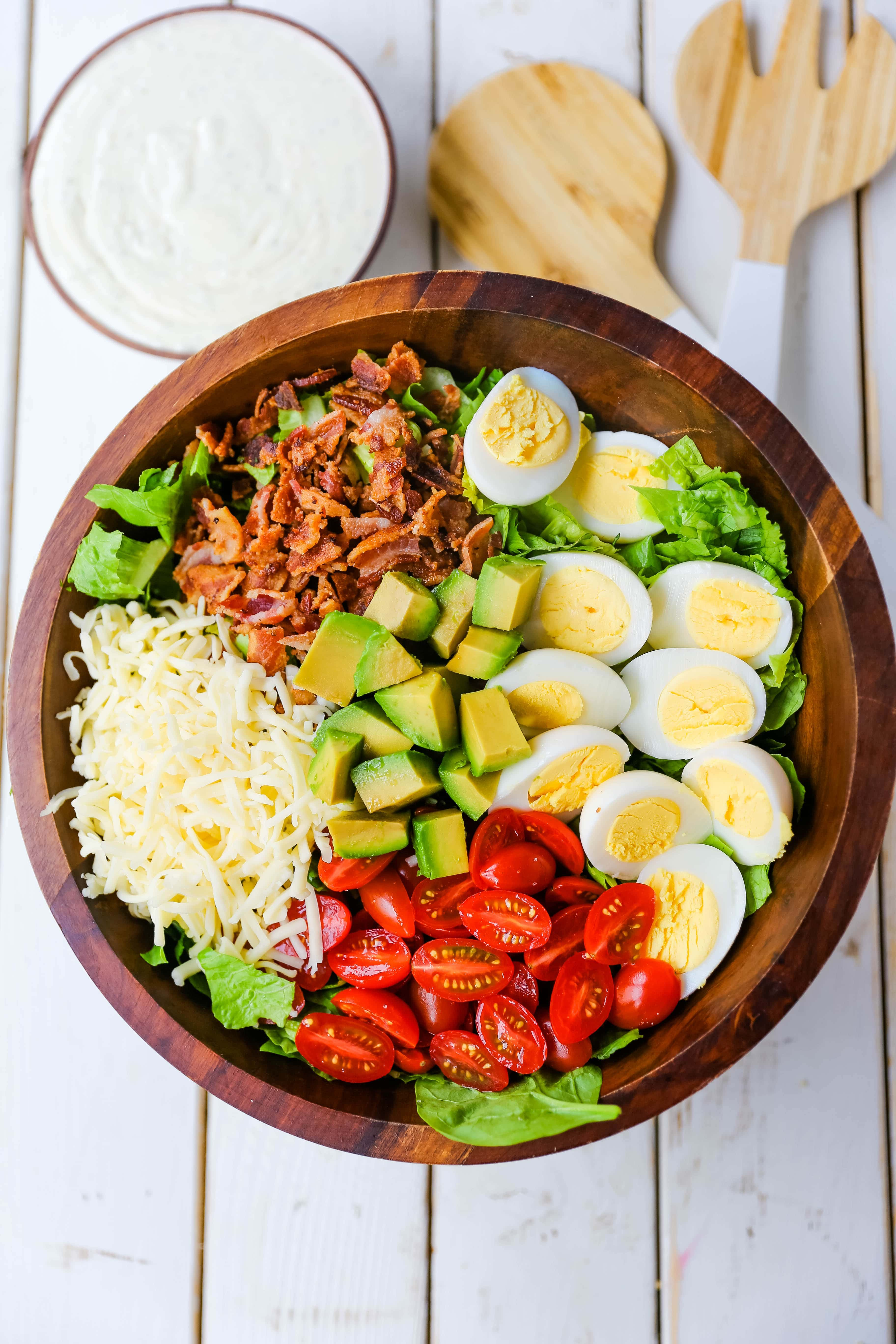 Cobb Salad made with romaine lettuce, crispy bacon, creamy avocado, juicy tomato, egg, Monterey Jack cheese, tossed in homemade Ranch dressing. www.modernhoney.com #salad #cobbsalad #salads