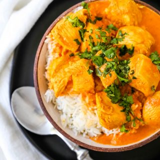 Indian Butter Chicken. A popular Indian dish made with tender chicken simmered in a rich, Indian spiced tomato cream sauce. www.modernhoney.com #butterchicken #indianbutterchicken