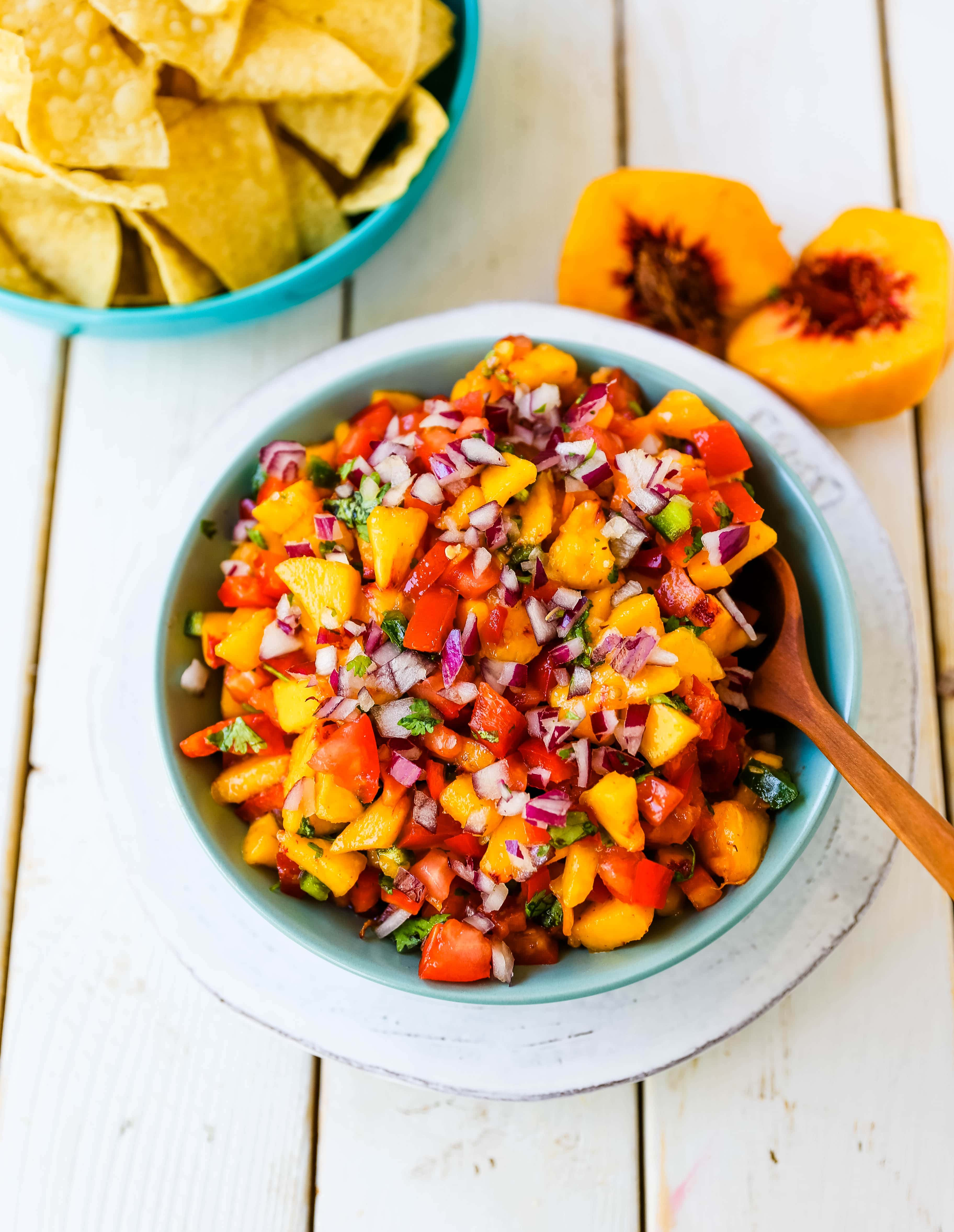 Peach Salsa. Fresh peach salsa with red pepper, jalapeño, red onion, tomatoes, cilantro, and fresh lime juice. A sweet and savory salsa perfect to pair with chips, grilled chicken or pork. www.modernhoney.com #peachsalsa #salsa #peachrecipes