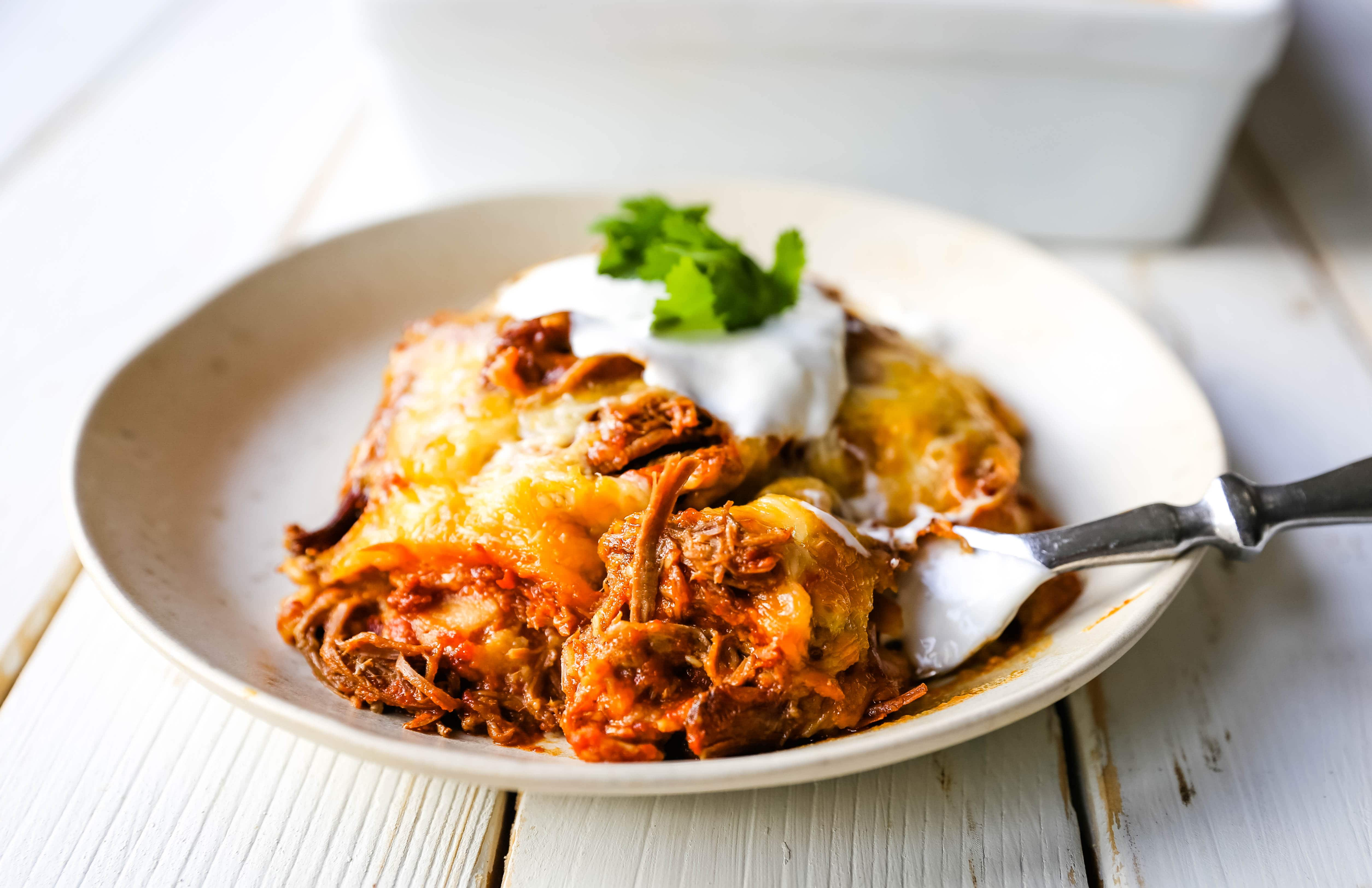 Stacked Beef Enchiladas. Mexican seasoned shredded beef enchiladas with melted cheese, corn tortillas, and homemade enchilada sauce. An easy beef enchilada casserole! #mexican #mexicanfood #enchiladas #beefenchiladas