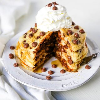 Chocolate Chip Pancakes The Best Homemade light, fluffy buttermilk pancakes with sweet milk chocolate chips. It makes the most decadent breakfast! www.modernhoney.com #pancakes #chocolatechippancakes #chocolatepancakes