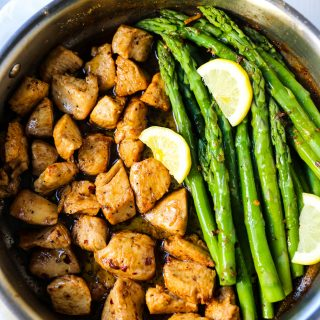 Garlic Butter Chicken and Asparagus Skillet A quick and easy one skillet dinner made with sautéed chicken and asparagus tossed in garlic butter. www.modernhoney.com #chicken #skilletdinner #chickendinner