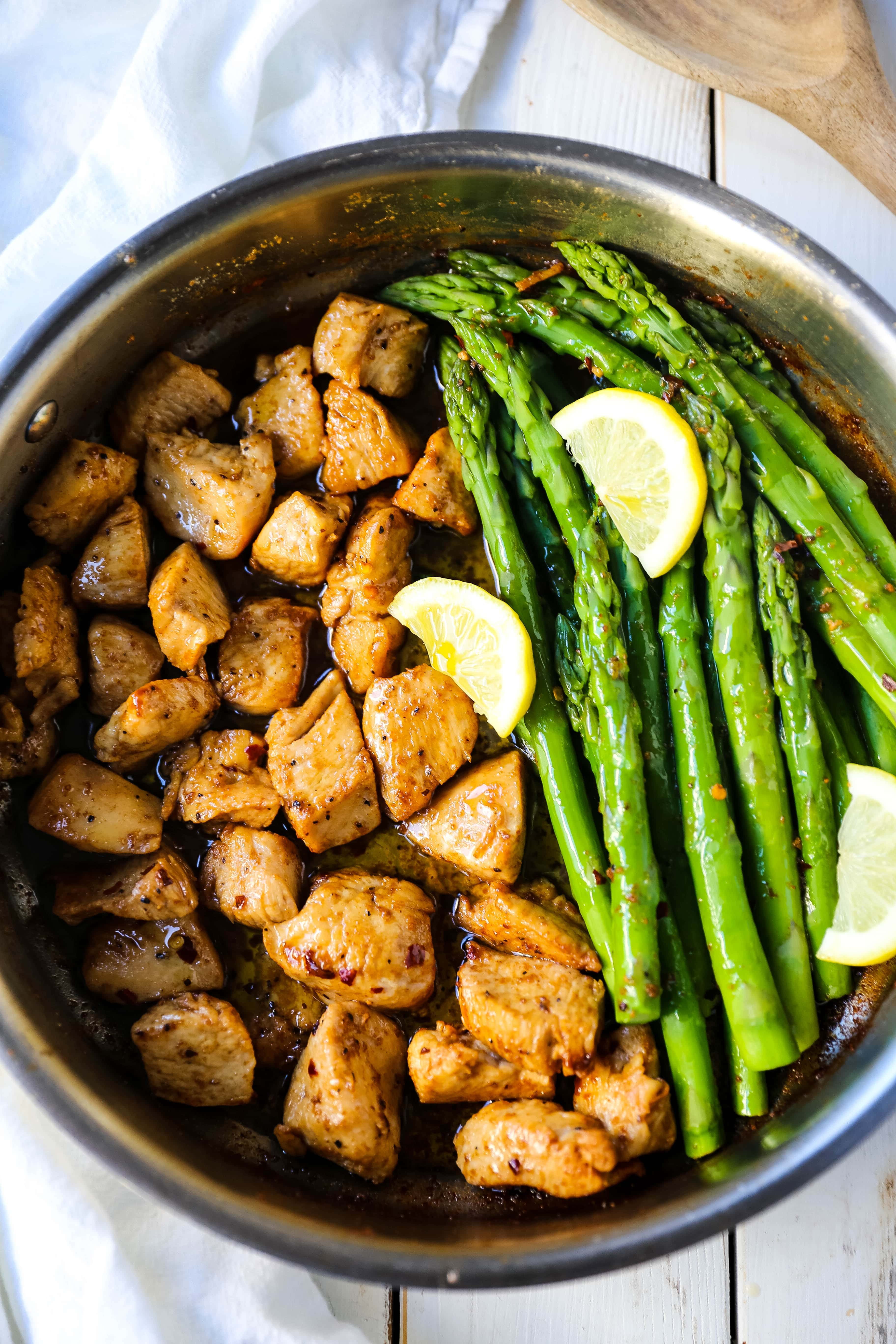 Garlic Butter Chicken and Asparagus Skillet A quick and easy one skillet dinner made with sautéed chicken and asparagus tossed in garlic butter.