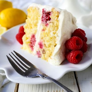 The Best Lemon Raspberry Cake. A light and fluffy lemon cake with fresh raspberries and a fresh lemon cream cheese frosting. A sweet and tangy lemon berry cake! #lemoncake #cake #lemonraspberrycake