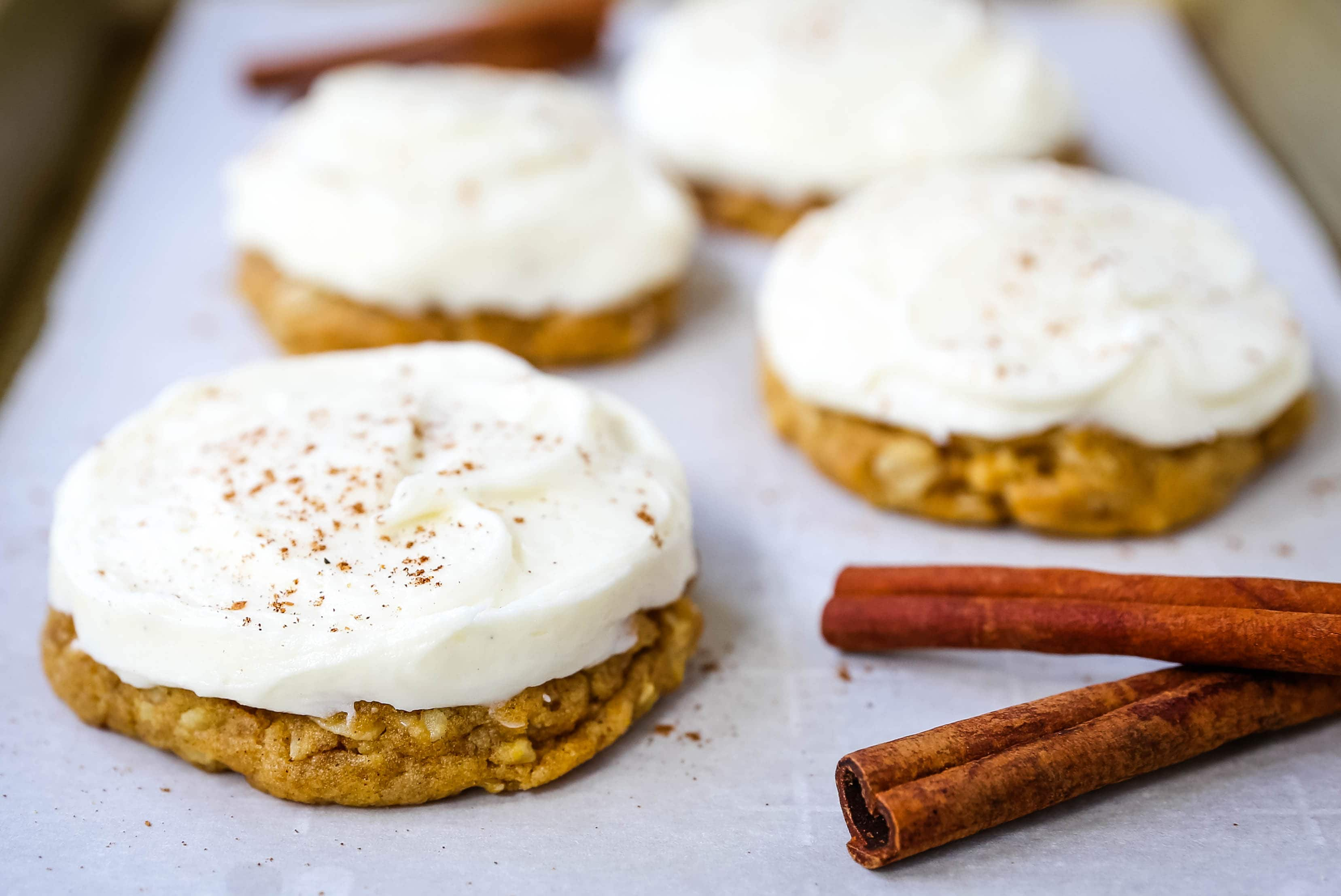 The BEST PUMPKIN COOKIES with CREAM CHEESE FROSTING Soft chewy pumpkin spiced cookies with a fluffy sweet cream cheese frosting. The perfect frosted pumpkin cookie recipe! www.modernhoney.com #pumpkin #pumpkincookies #frostedpumpkincookies #fall #fallrecipes