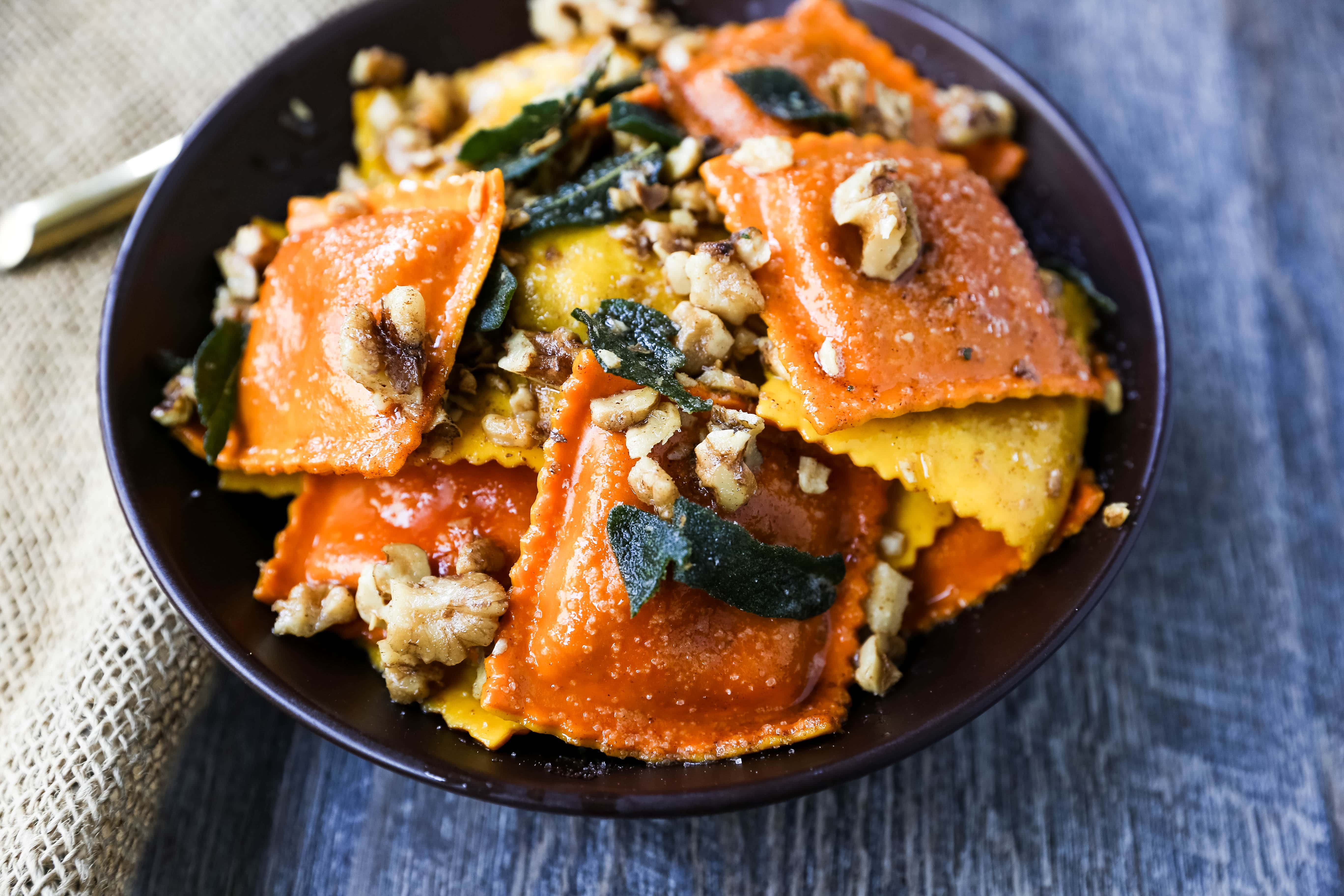 Ravioli with Browned Butter and Sage Fresh ravioli tossed in a browned butter sauce with crispy sage and toasted walnuts. A bowl of rich, creamy comfort food! www.modernhoney.com #ravioli #pasta #pumpkinravioli