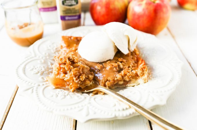 Caramel Apple Slab Pie Juicy cinnamon sugar apples baked in a flaky pie crust and topped with a buttery brown sugar crumb topping then drizzled with homemade salted caramel. An easy way to make apple pie to feed a crowd! www.modernhoney.com #applepie #apples #caramelapplepie #appleslabpie #slabpie