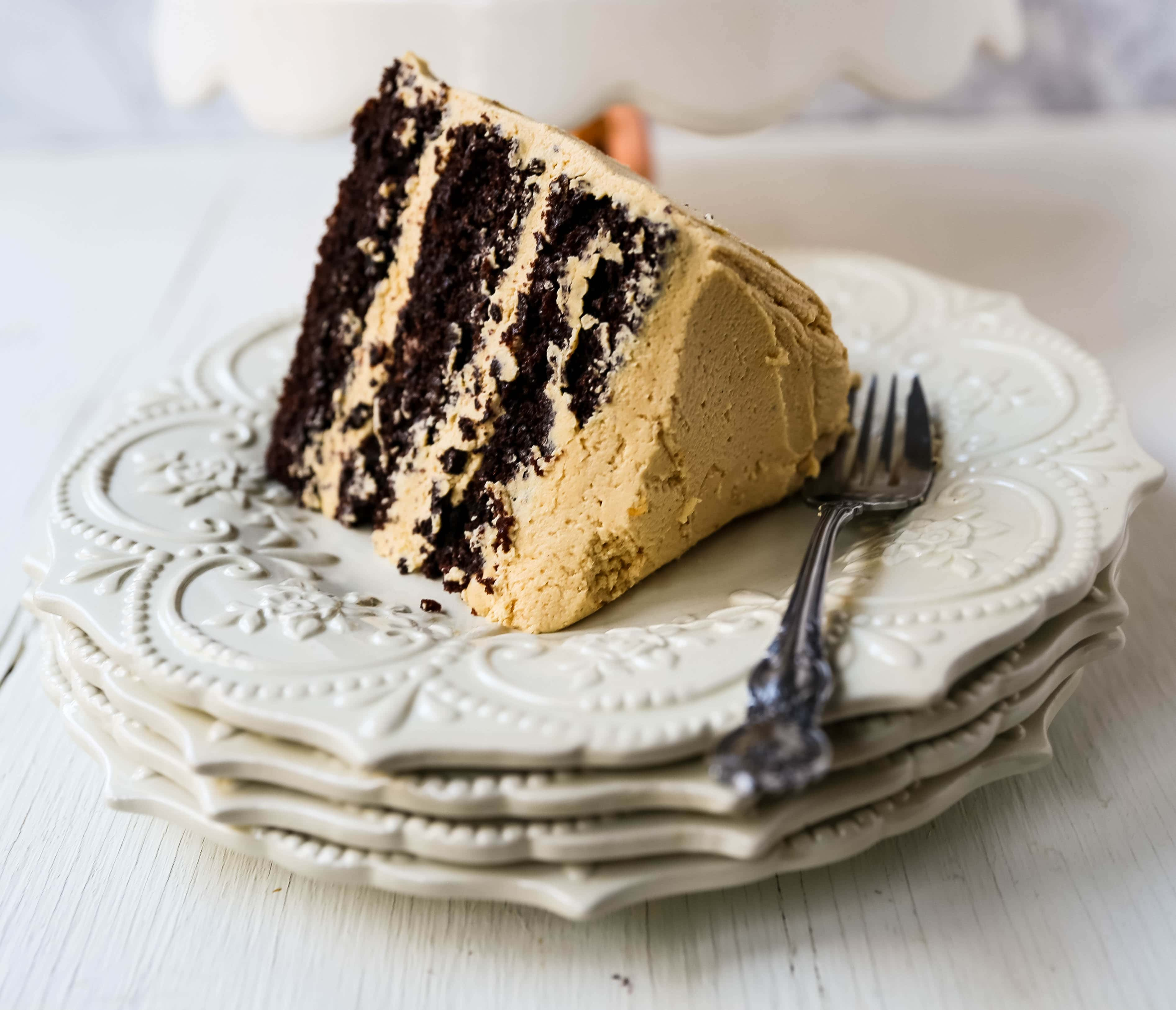 Chocolate Cake with Peanut Butter Frosting A moist 5-Star Rated Chocolate Cake with Creamy Peanut Butter Frosting topped with Peanut Butter Cups. www.modernhoney.com #peanutbutter #chocolatepeanutbuttercake #chocolatecake