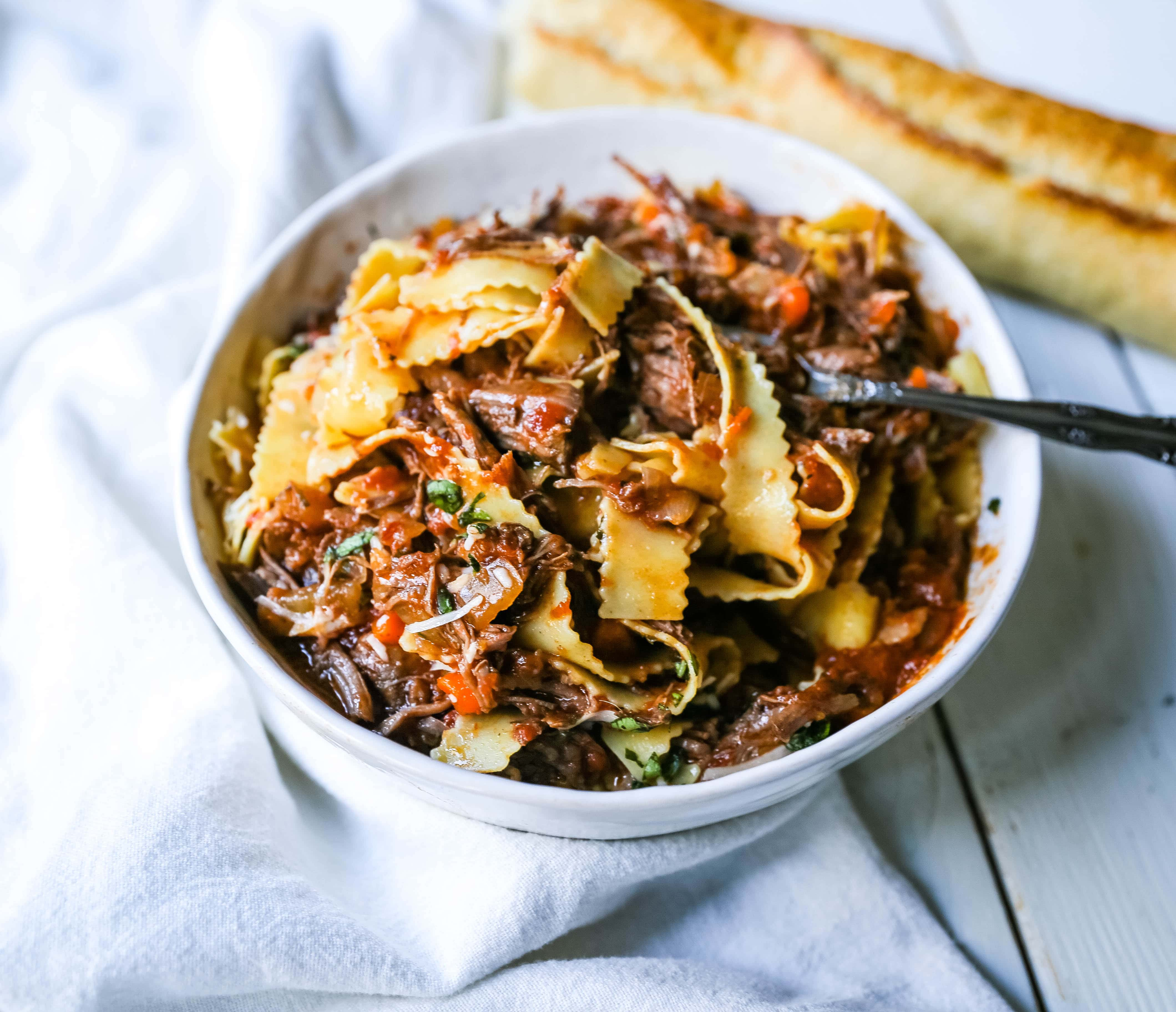 Sunday Slow Cooker Beef Ragu. Authentic Italian Beef Ragu. The ultimate comfort food! A big bowl of slow cooked, braised beef in a rich, robust tomato sauce tossed with pasta. I guarantee that you will go back for seconds! www.modernhoney.com #slowcooker #beefragu #italianfood #italian