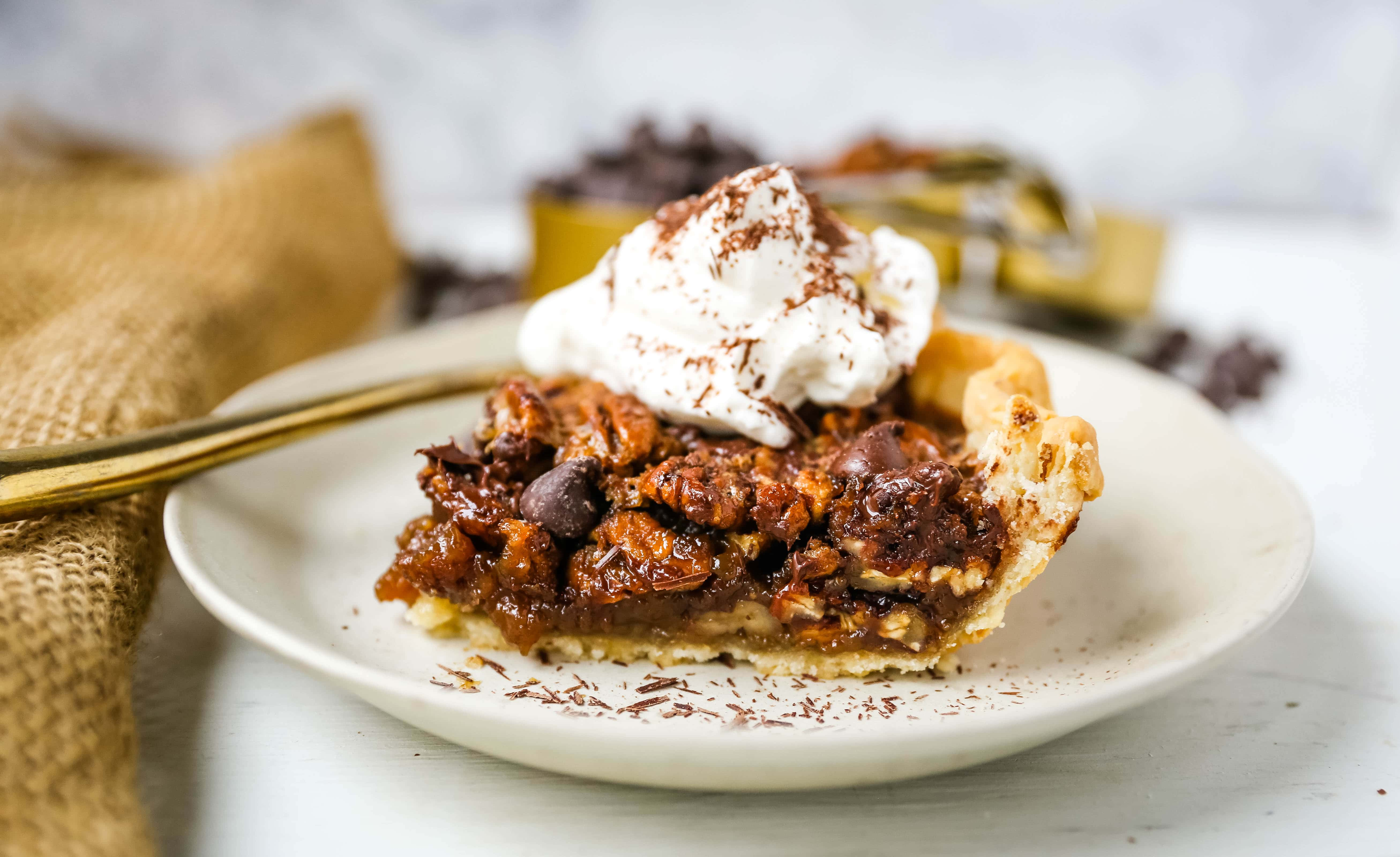 Chocolate Pecan Pie Rich chocolate pecan pie made with a brown sugar filling, crunchy pecans, rich chocolate, all in a homemade buttery, flaky pie crust. www.modernhoney.com #pie #pecanpie #chocolatepecanpie #thanksgiving #pies