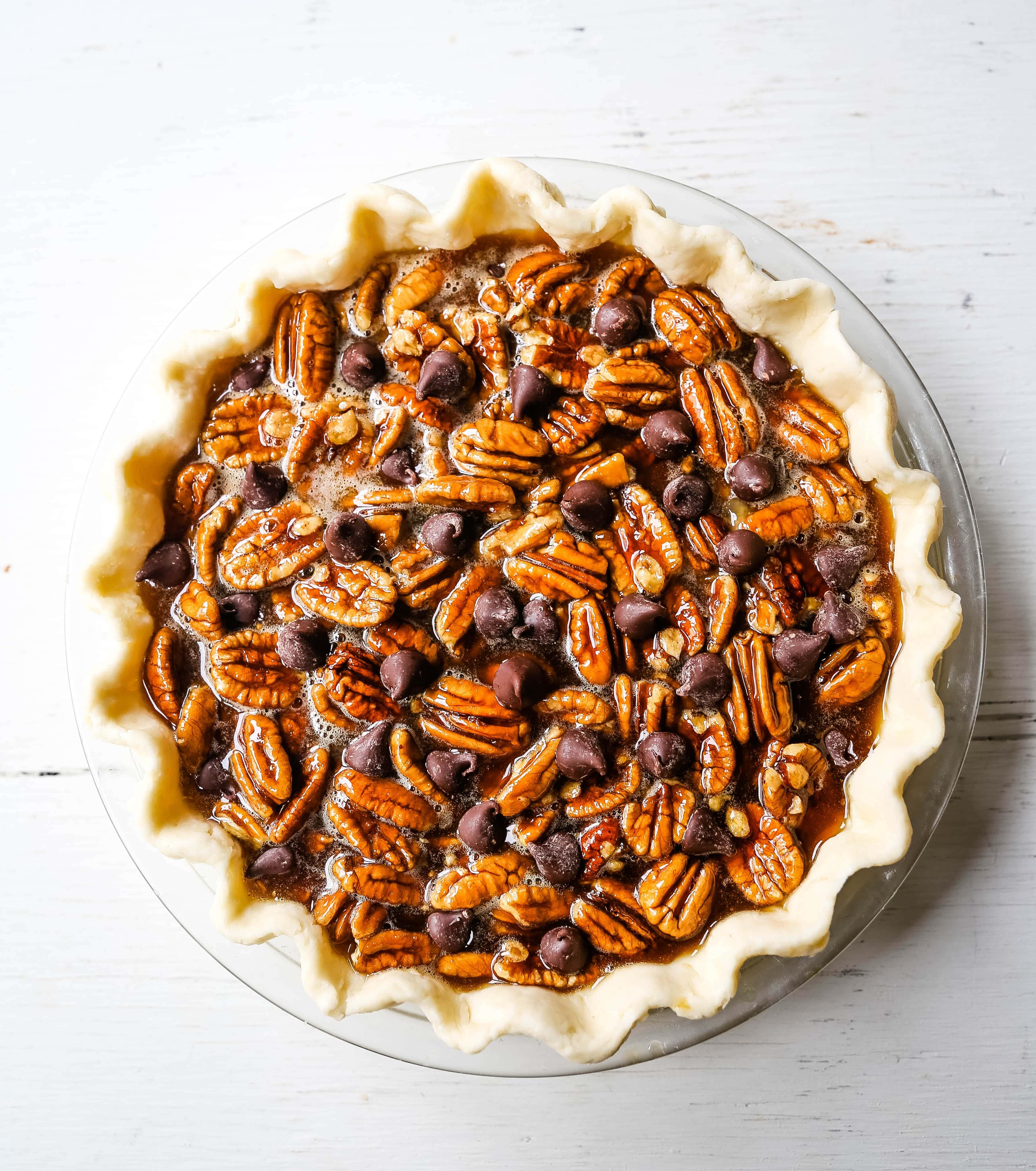 Chocolate Pecan Pie Rich chocolate pecan pie made with a brown sugar filling, crunchy pecans, rich chocolate, all in a homemade buttery, flaky pie crust.www.modernhoney.com #pie #pecanpie #chocolatepecanpie #thanksgiving #pies
