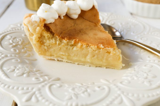 Creme Brûlée Pie. A silky smooth vanilla custard in a buttery crust topped with a crisp sugar topping. It is a creamy sweet pie with a touch of tang and will be everyone's favorite pie! www.modernhoney.com #thanksgiving #pie #pies #thanksgivingrecipes #cremebrulee