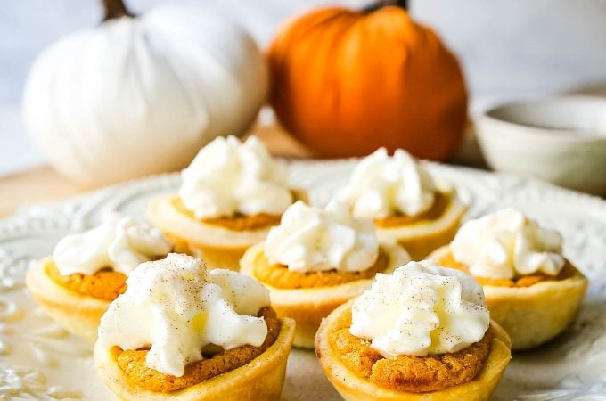 Mini Pumpkin Pie Bites. The best bite-size mini pumpkin pies perfect for entertaining during the holiday season. Creamy pumpkin pie filling in buttery pie crust cups topped with fresh whipped cream.  www.modernhoney.com #pumpkinpie #pumpkinpiebites #minipumpkinpies