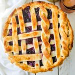Triple Berry Pie. The best homemade berry pie recipe with a buttery pie crust. Top it with vanilla bean ice cream and you have the perfect berry dessert! The best berry pie recipe. www.modernhoney.com #berrypie #pie #berries #tripleberrypie #thanksgiving