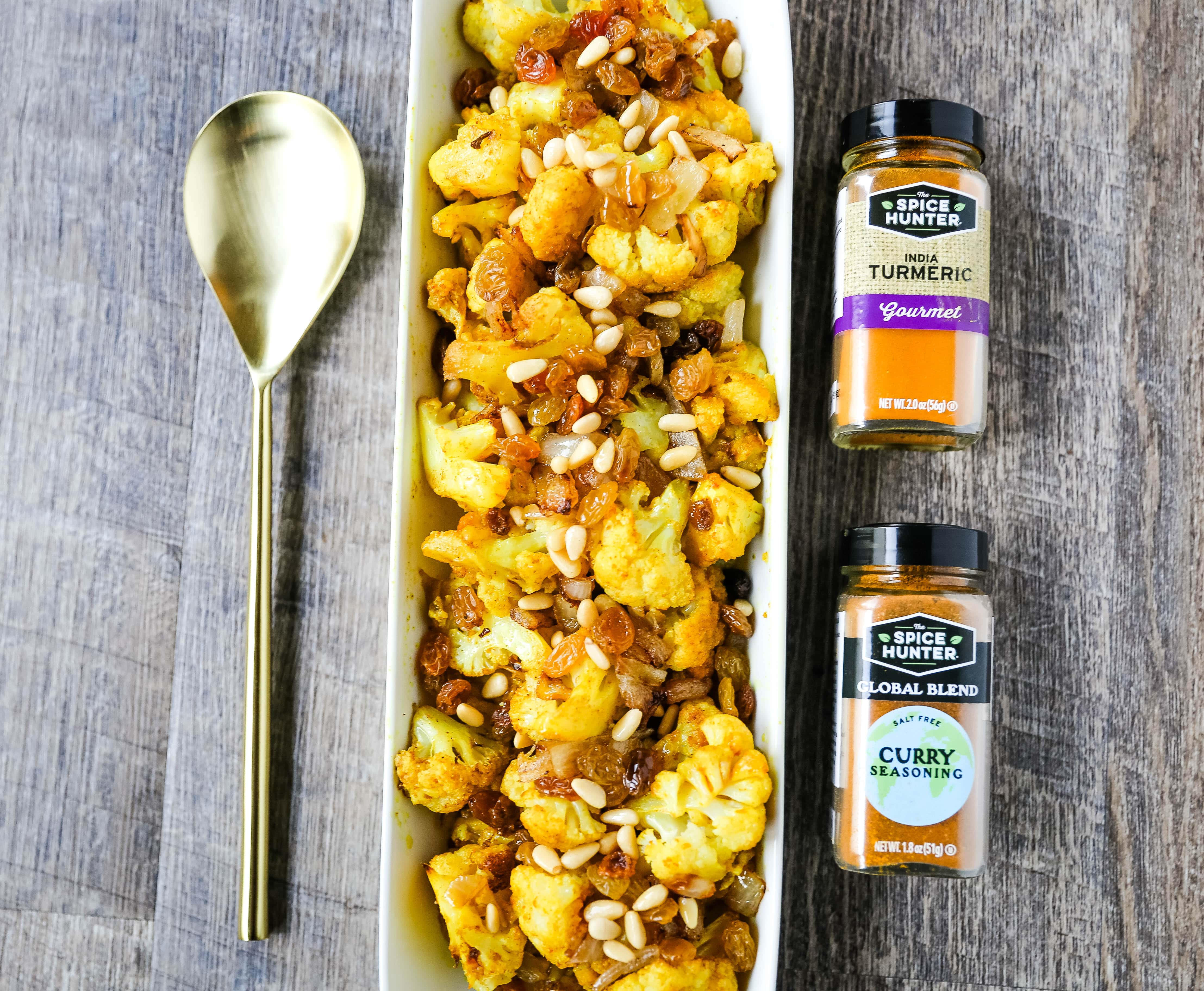 Turmeric Roasted Cauliflower Indian spiced roasted cauliflower with warm spices, caramelized onions, sweet golden raisins, and crunchy pine nuts. A flavorful, healthy side dish perfect for any occasion! www.modernhoney.com #cauliflower #sidedish #roastedvegetables #indianfood