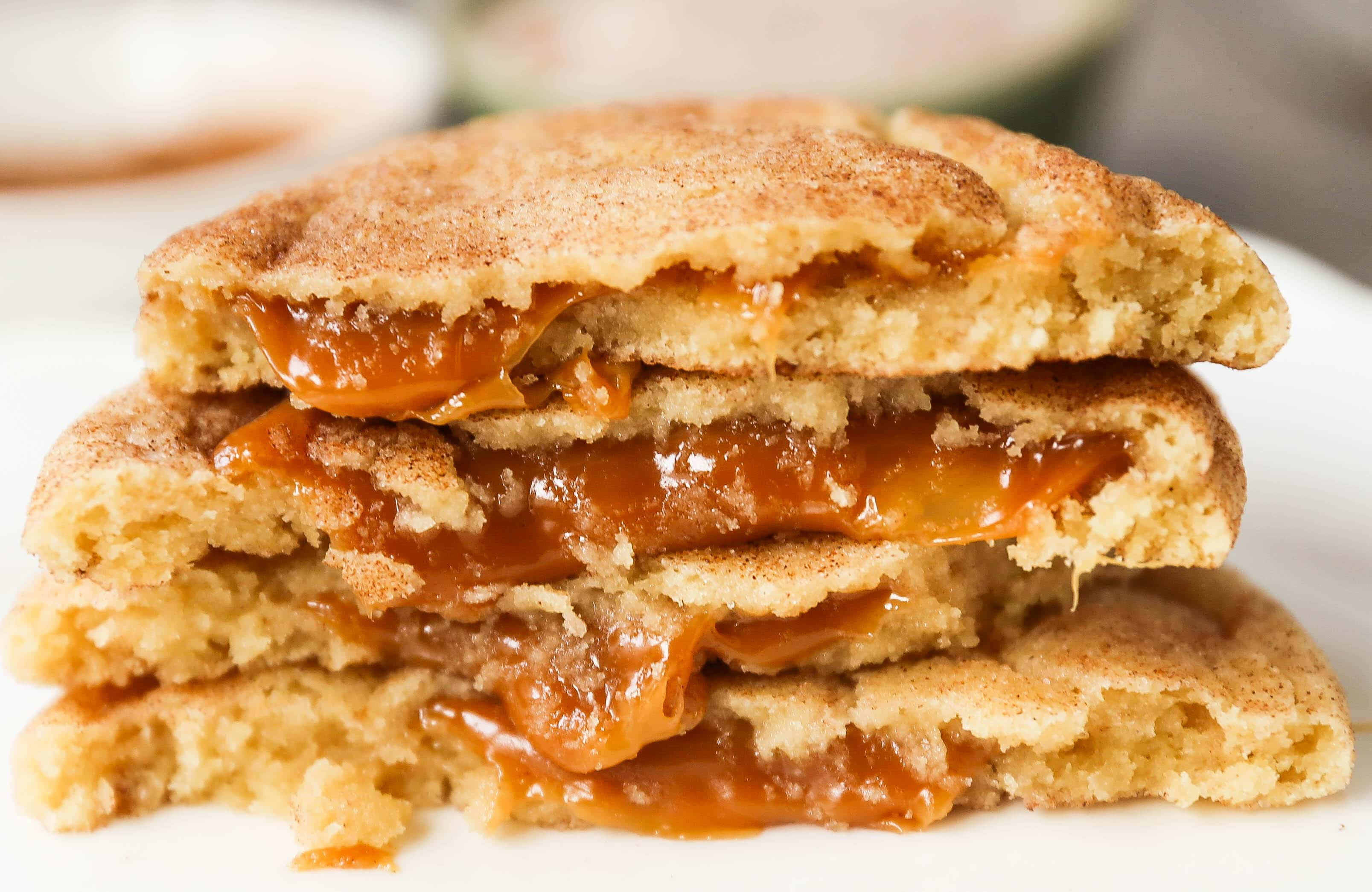 Caramel Filled Snickerdoodle Cookies Soft chewy cinnamon sugar snickerdoodle cookies stuffed with buttery caramel. The perfect caramel stuffed snickerdoodle cookie recipe! www.modernhoney.com #caramelsnickerdoodles #christmascookies #cookie #cookies