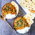 Coconut Chickpea Curry A rich coconut curry broth with onion, garlic, ginger, Indian spices in coconut milk and tossed with chickpeas. Flavorful vegan meal and you won't even miss the meat! www.modernhoney.com #vegan #curry #indianfood #vegancurry #chickpeacurry