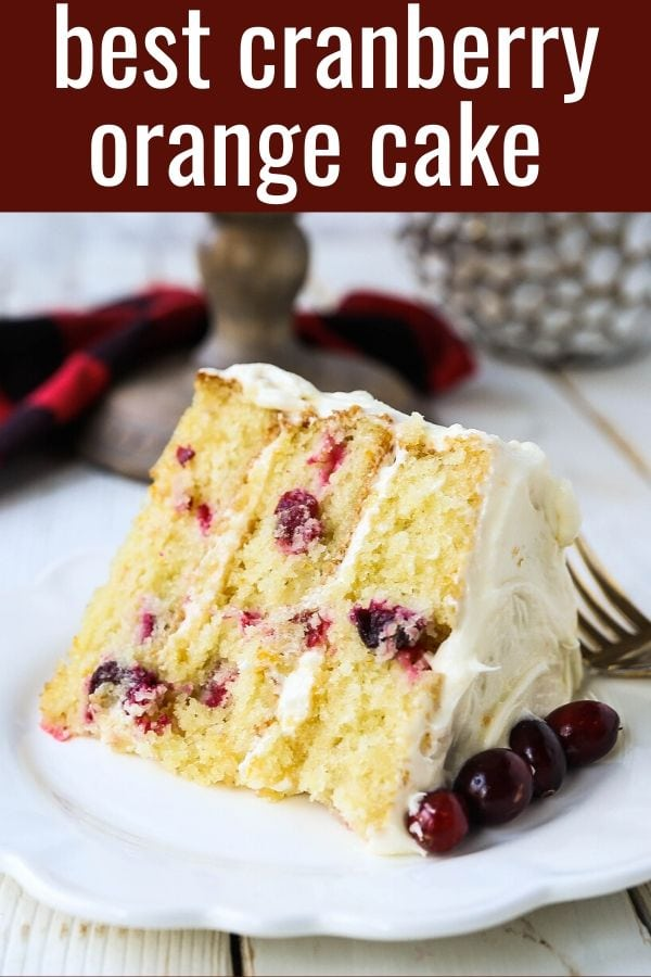 Cranberry Orange Cake. A moist orange zest cake with fresh cranberries with a sweet cream cheese orange frosting. A sweet yet tart holiday cake. www.modernhoney.com #cranberry #cranberrycake #cranberryorange #cranberryorangecake