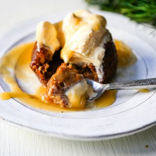 Sticky Toffee Pudding A famous English dessert with a moist sponge cake covered in a homemade caramel toffee sauce and vanilla ice cream. The perfect Christmas dessert or holiday dessert recipe. A Christmas traditional dessert. www.modernhoney.com #stickytoffeepudding #toffeepudding #stickypudding #datecake