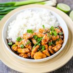 Asian Sticky Chicken Tender chicken sauteed in a sticky sweet and tangy Asian sauce served with creamy coconut rice. A quick and easy 20-minute dinner! www.modernhoney.com #asianfood #chinesefood #stickychicken #chicken