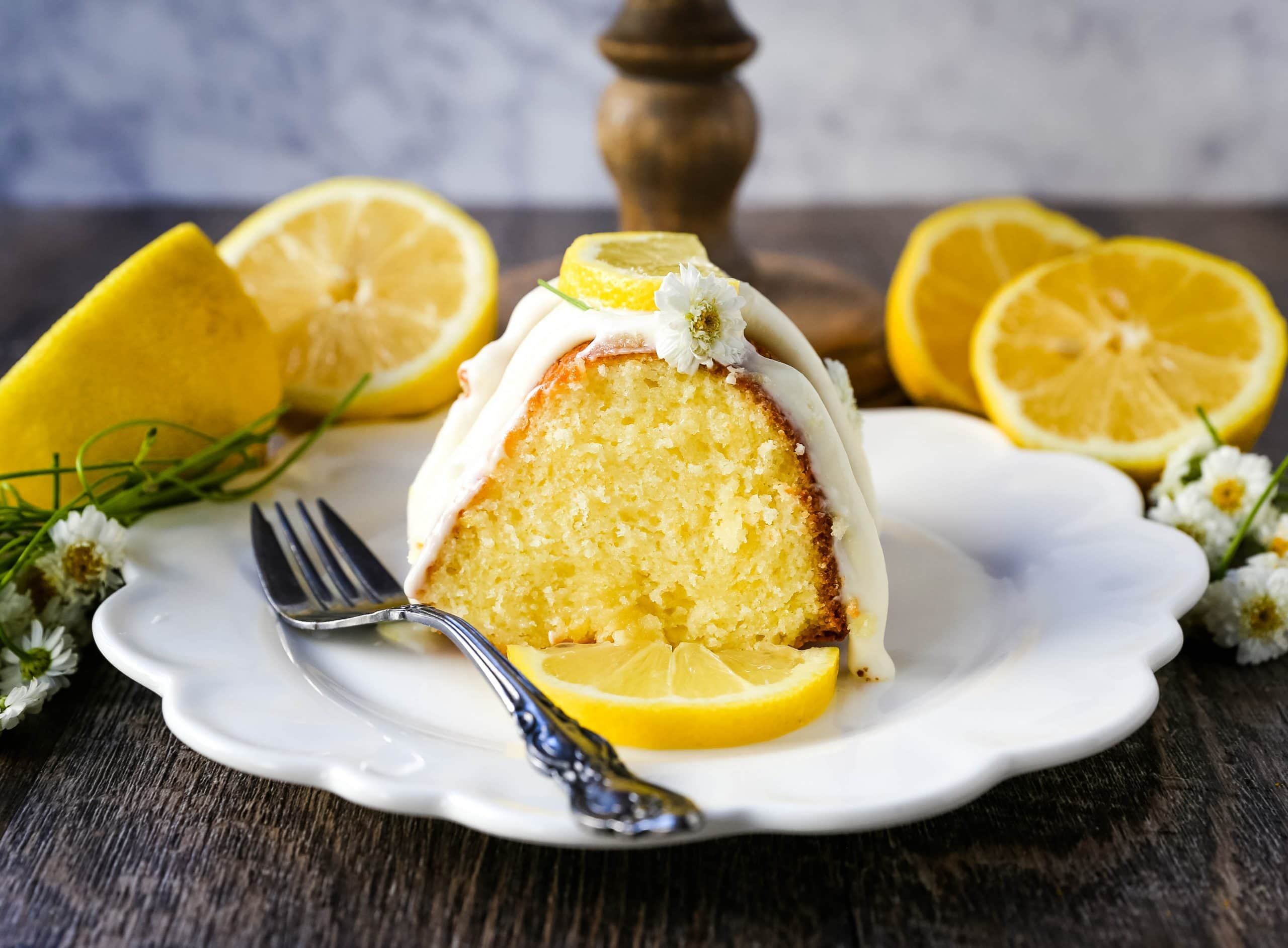 Lemon Bundt Cake. Moist, flavorful lemon bundt cake with a fresh cream cheese lemon glaze. Tips and tricks for making the perfect lemon bundt cake. www.modernhoney.com #lemoncake #lemonbundtcake #bundtcake #cake