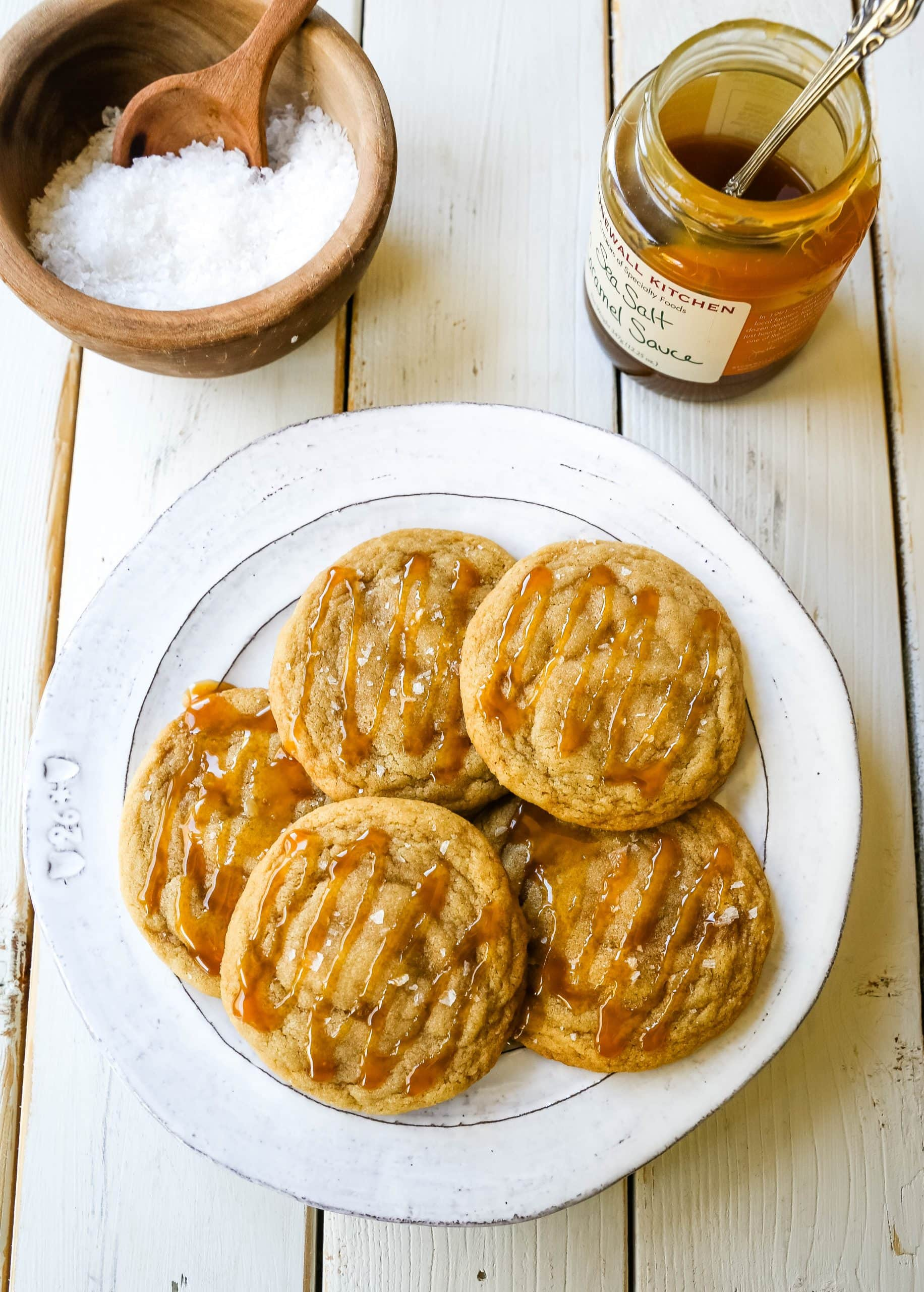 Salted Caramel Cookies Soft chewy caramel cookies with sea salt and drizzled with salted caramel. www.modernhoney.com #cookie #cookies #caramel #caramelcookie #saltedcaramel #seasaltcaramel