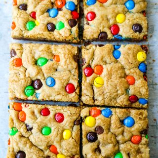 M & M Cookie Bars Soft chewy brown sugar M & M blondie cookie bars. The best M & M Cookie Bars recipe! www.modernhoney.com #bars #dessertbars #chocolatechipcookiebars