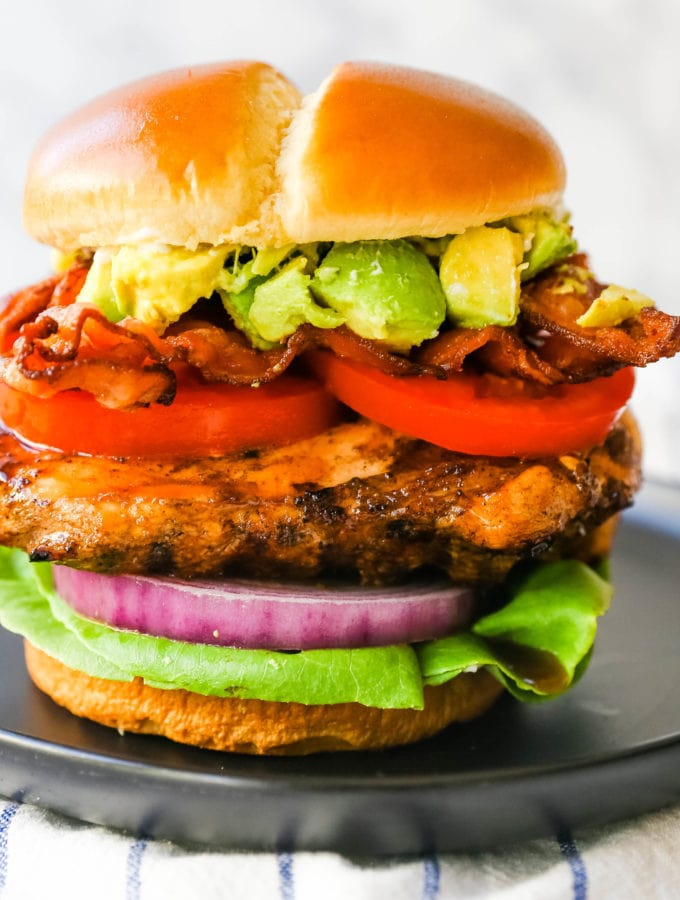 Avocado Bacon Grilled Chicken Sandwich Juicy marinated grilled chicken breast with crispy bacon, creamy avocado, juicy tomato, crisp lettuce, all on a brioche bun. www.modernhoney.com #grilledchickensandwich #chickensandwich