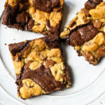 Brookies (Chocolate Chip Cookie and Brownie Bars) A homemade decadent chocolate brownie and chocolate chip cookie all in one! A brownie and chocolate chip cookie just got married. The best dessert bar! www.modernhoney.com #brookie #brookies #brownies #dessertbar