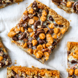 7-Layer Magic Bars. The famous dessert bars made with a graham cracker crust, sweetened flaked coconut, chocolate chips, butterscotch chips, nuts, all drizzled with sweetened condensed milk. The perfect dessert bar recipe! www.modernhoney.com #7layerbars #magicbars #magiccookiebars #sevenlayerbars