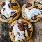 Chocolate Chip S'mores Cookies Warm milk chocolate chip cookies with creamy marshmallow fluff and graham cracker. The most perfect s'mores and chocolate chip cookie in one! www.modernhoney.com #cookies #smores #smorescookies #chocolatechipcookies