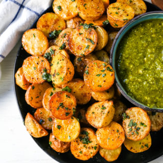 Oven Roasted Potatoes Garlic Roasted Roasted Potatoes with buttery Yukon gold potatoes baked with olive oil, garlic butter, and sprinkled with fresh parsley. The Best Roasted Potatoes recipe! www.modernhoney.com #potatoes #roastedpotatoes #sidedish