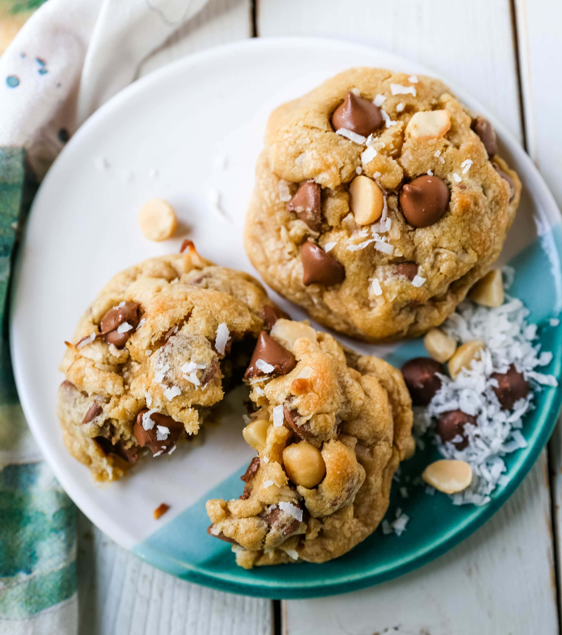 Milk Chocolate Chip Macadamia Nut Coconut Cookies Thick soft and chewy bakery-style milk chocolate chip macadamia nut coconut cookies are an Island favorite!  www.modernhoney.com #cookies #chocolatechipmacadamianut
