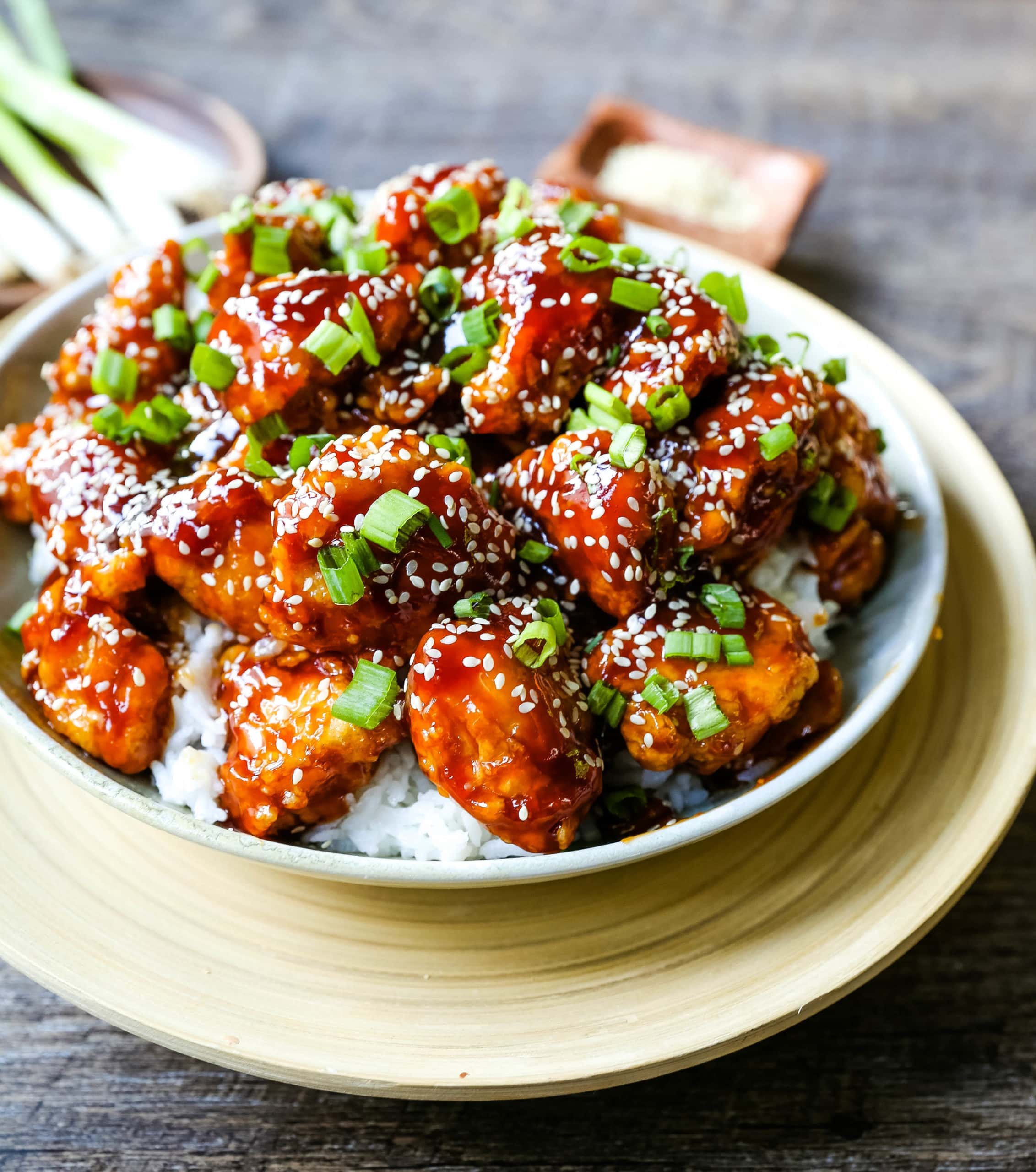 Sesame Chicken. Homemade Chinese Sesame Chicken made with crispy fried chicken covered in a sweet and sour sauce. The ultimate sesame chicken recipe is way better than take-out. www.modernhoney.com #sesamechicken #chinesefood